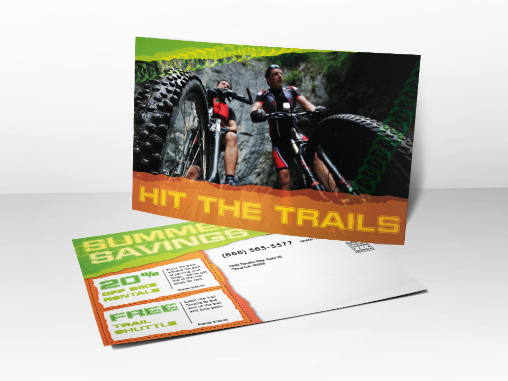 An advertising postcard for companies that sell road bikes and mountain bikes with a picture of two guys mountain biking.